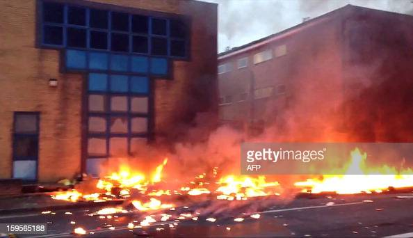 A stills grab from television footage taken by a member of the public shows flames on a road following the crash of a helicopter in central London on...