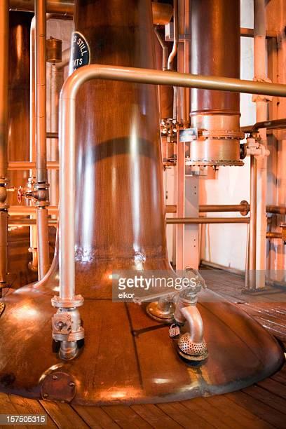 Stills in a whiskey distillery, Islay, Scotland.