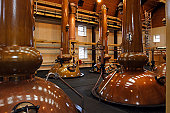Stills in a famous scottish whisky distillery. They are the tallest in Scotland.