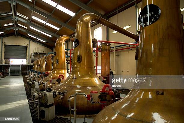 Stills Inside a Scottish whiskey distillery
