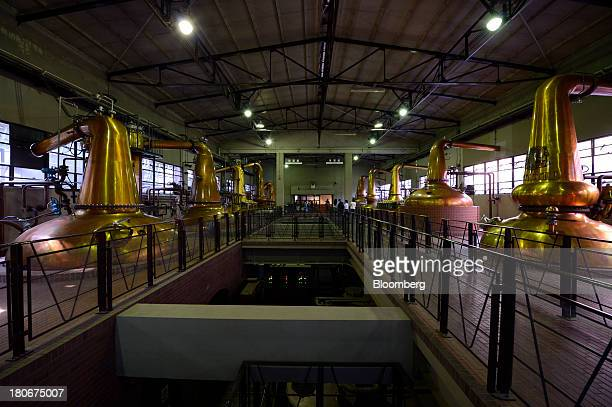 Stills sit at Suntory Holdings Ltd's Yamazaki distillery in Shimamoto Osaka Japan on Friday Sept 13 2013 Suntory is a household name in Japan selling...