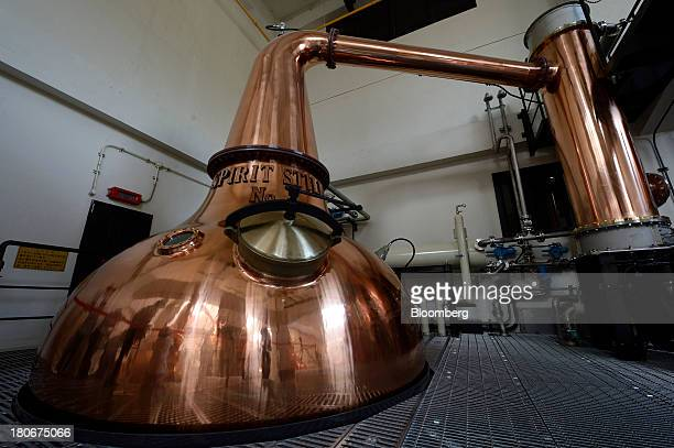 Stills sit at Suntory Holdings Ltd's Yamazaki distillery in Shimamoto Osaka Japan on Friday Sept 13 2013 Suntory is a household name in Japan selling...