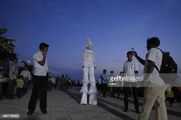 A stilt walker amuses the crowds at Worli festival which is being celebrated at Worli Sea Face on January 27 2013 in Mumbai India The three days of...