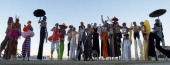 DESERT NV Stilt walkers pose for a group shot after sunset at Burning Man an arts festival and party that transforms the desert into a city of 35000...