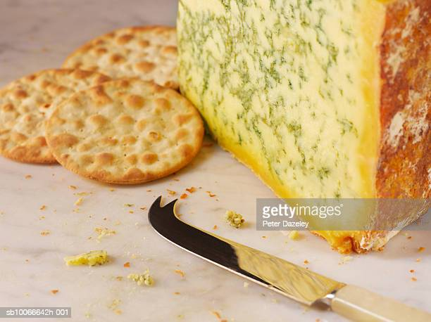 Stilton and crackers with knife, close-up