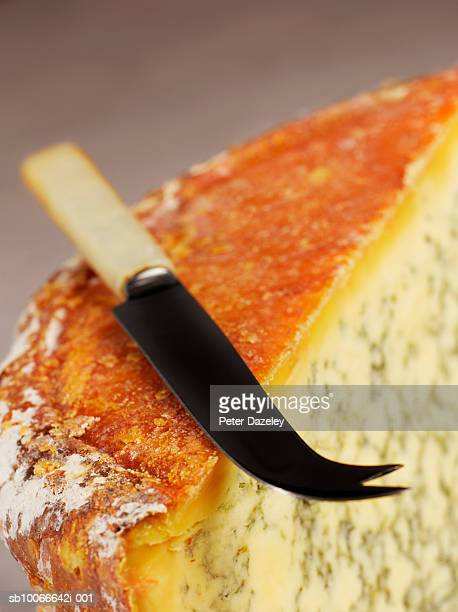 Stilton with cheese knife, close-up