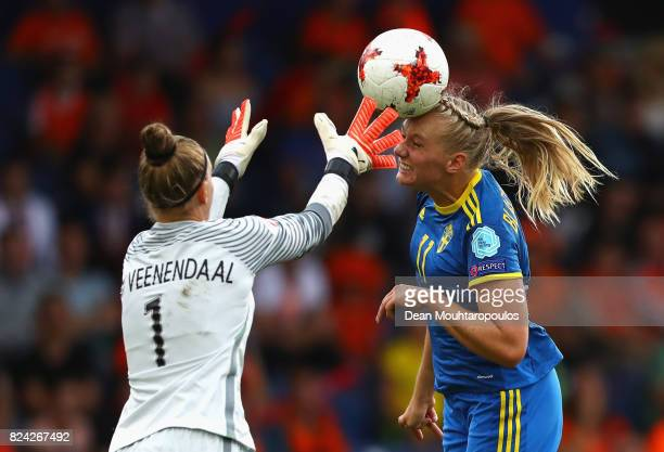Stina Blackstenius of Sweden heads the ball past Sari van Veenendaal of the Netherlands during the UEFA Women's Euro 2017 Quarter Final match between...