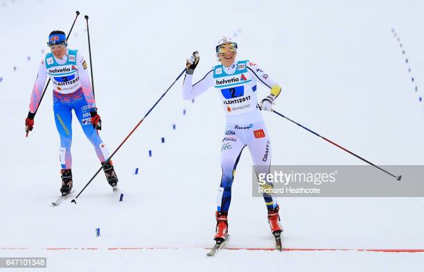 Stina Nilsson of Sweden celebrates as she wins silver ahead of Krista Parmakoski of Finland during the Women's Cross Country 4x5km Relay at the FIS...