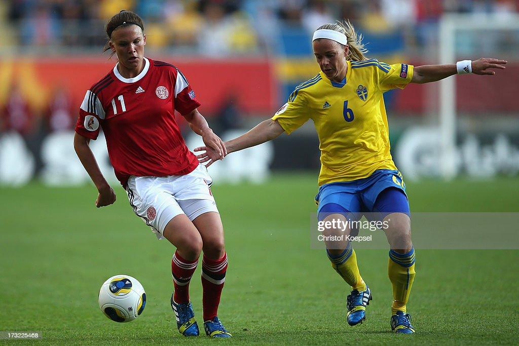 Stina Segerstroem of Sweden (R) challenges Katrine Veje of Denmark (L) during the UEFA Women's EURO 2013 Group A match between Sweden and Denmark at Gamla Ullevi Stadium on July 10, 2013 in Gothenburg, Sweden.
