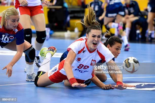 Stine Bredal Oftedal of Norway Kinga Achruk of Poland and Nora Mork of Norway in action during IHF Women's Handball World Championship match between...