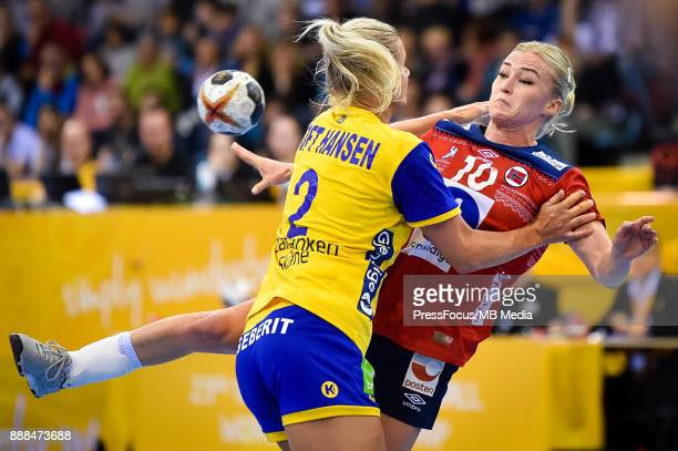 Stine Bredal Oftedal of Norway passes the ball during IHF Women's Handball World Championship group B match between Norway and Sweden on December 08...