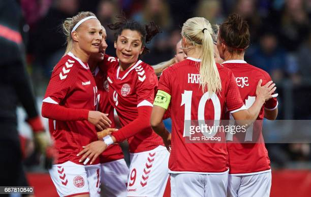 Stine Larsen Nadia Nadim and Pernille Harder of Denmark celebrate after scoring their second goal during the international friendly match between...