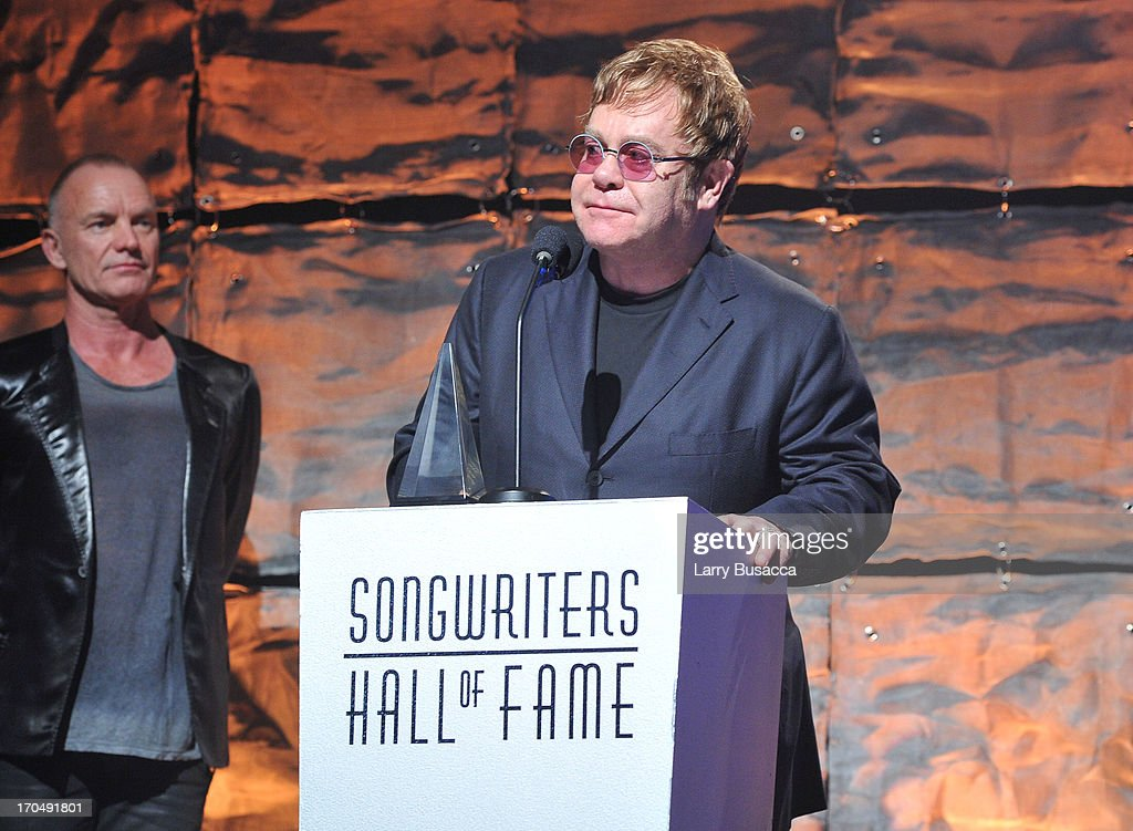 Sting and <a gi-track='captionPersonalityLinkClicked' href=/galleries/search?phrase=Elton+John&family=editorial&specificpeople=171369 ng-click='$event.stopPropagation()'>Elton John</a> speak onstage at the Songwriters Hall of Fame 44th Annual Induction and Awards Dinner at the New York Marriott Marquis on June 13, 2013 in New York City.
