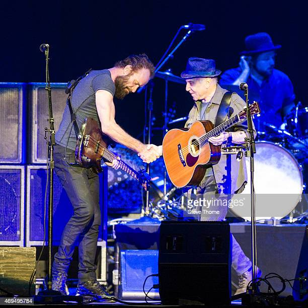 Sting and Paul Simon perform on stage at Genting Arena on April 12 2015 in Birmingham United Kingdom