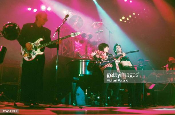 Sting and Ron Wood perform on stage with Prince at Wembley Arena London 14th August 1986