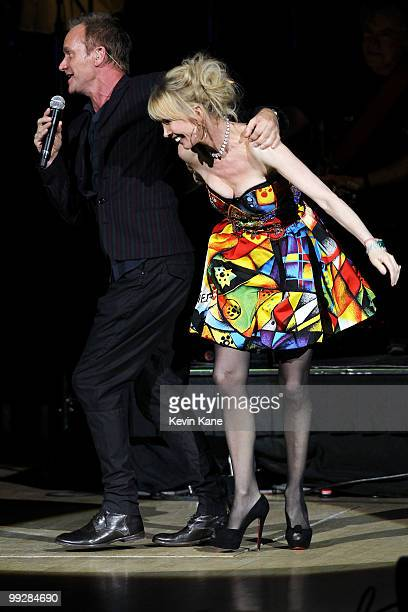 Sting and Trudie Styler perform on stage during the Almay concert to celebrate the Rainforest Fund's 21st birthday at Carnegie Hall on May 13 2010 in...