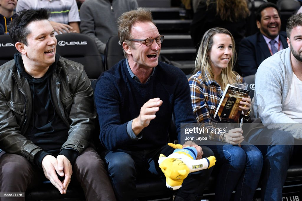 Sting laughs at Denver Nuggets mascot as he attends the game against the Minnesota Timberwolves February 15, 2017 at Pepsi Center.