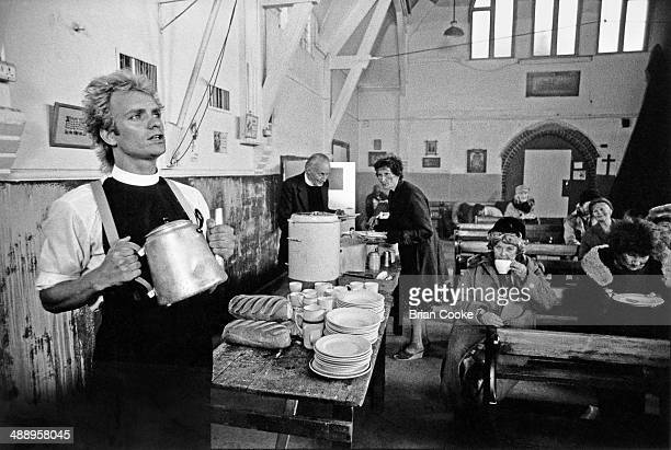 Sting performing while making a promotional film for his single Spread A Little Happiness from his album Brimstone and Treacle at a church hall in...