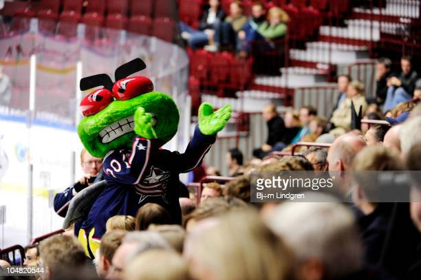 Stinger the Columbus Blue Jackets mascot performs during a preseason game against the Mif Redhawks at the Malmo Arena on October 5 2010 in Malmo...