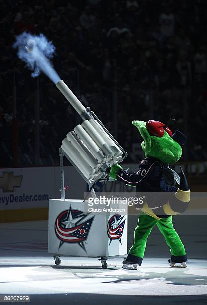 Stinger the Mascot of the Columbus Blue Jackets fires a tee shirt into the crowd prior to game against the Detroit Red Wings during Game Four of the...