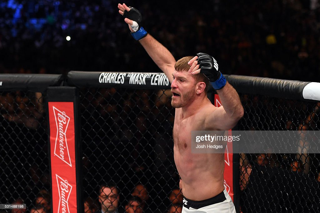 Stipe Miocic celebrates after defeating Fabricio Werdum of Brazil by KO in their UFC heavyweight championship bout during the UFC 198 event at Arena da Baixada stadium on May 14, 2016 in Curitiba, Parana, Brazil.