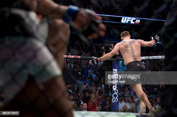 Stipe Miocic celebrates after defeating Junior dos Santos during UFC 211 at the American Airlines Center on May 13 2017 in Dallas Texas