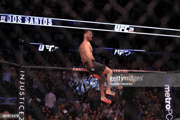Stipe Miocic celebrates his knockout win against Junior Dos Santos in their Heavyweight Title bout during UFC 211 at American Airlines Center on May...