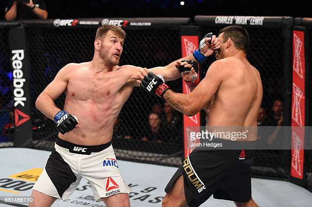 Stipe Miocic punches Fabricio Werdum of Brazil in their UFC heavyweight championship bout during the UFC 198 event at Arena da Baixada stadium on May...