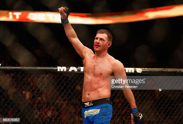 Stipe Miocic reacts in the octagon after being defeated by Junior dos Santos in an unanimous decision in their heavyweight bout during the UFC Fight...