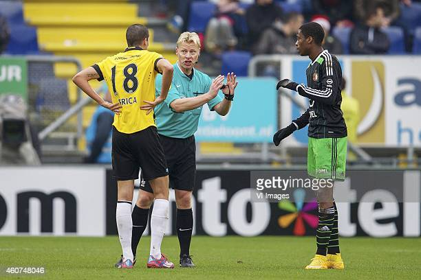Stipe Perica of NAC Breda referee Kevin Blom Terence Kongolo of Feyenoord during the Dutch Eredivisie match between NAC Breda and Feyenoord at the...