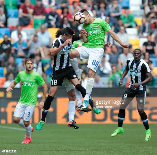 Stipe Perica of Udinese Calcio jumps for the ball with Alberto Grassi of Atalanta BC during the Serie A match between Udinese Calcio and Atalanta BC...