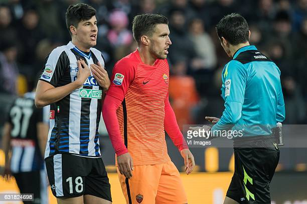 Stipe Perica of Udinese Kevin Strootman of AS Roma referee Antonio Damato di Barlettaduring the Italian Serie A match between Udinese and AS Roma at...