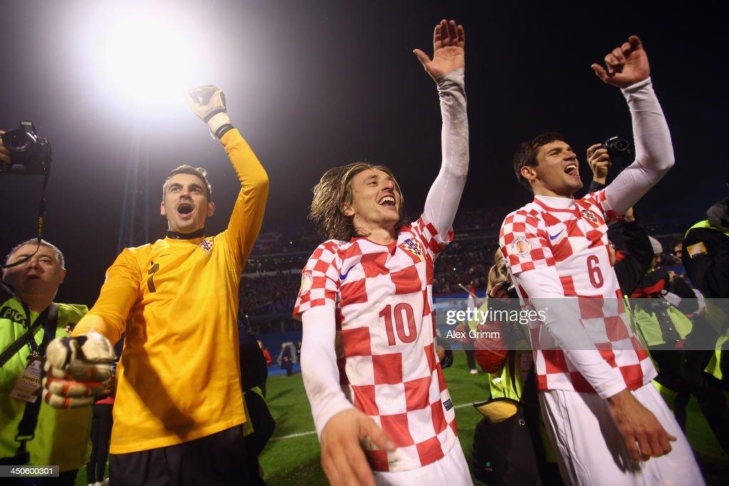 Stipe Pletikosa Luka Modric and Dejan Lovren of Croatia celebrate after the FIFA 2014 World Cup Qualifier playoff second leg match between Croatia...