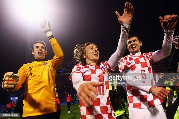 Stipe Pletikosa Luka Modric and Dejan Lovren of Croatia celebrate after the FIFA 2014 World Cup Qualifier playoff second leg match between Croatia...