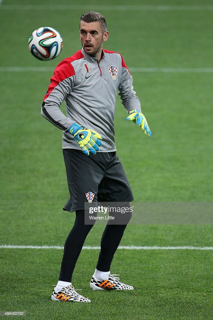 Stipe Pletikosa of Croatia controls the ball during a Croatia Training session ahead of the 2014 FIFA World Cup Brazil opening match against Brazil...