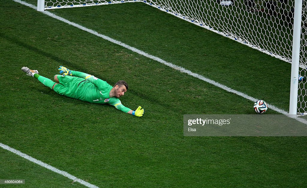 Stipe Pletikosa of Croatia dives and fails to make a save on a shot by Neymar of Brazil (not pictured) in the first half during the 2014 FIFA World Cup Brazil Group A match between Brazil and Croatia at Arena de Sao Paulo on June 12, 2014 in Sao Paulo, Brazil.