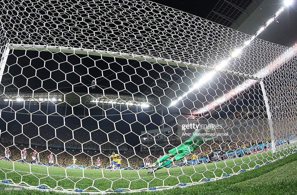 Stipe Pletikosa of Croatia dives attempting to save a penalty kick taken by Neymar of Brazil in the second half during the 2014 FIFA World Cup Brazil Group A match between Brazil and Croatia at Arena de Sao Paulo on June 12, 2014 in Sao Paulo, Brazil.