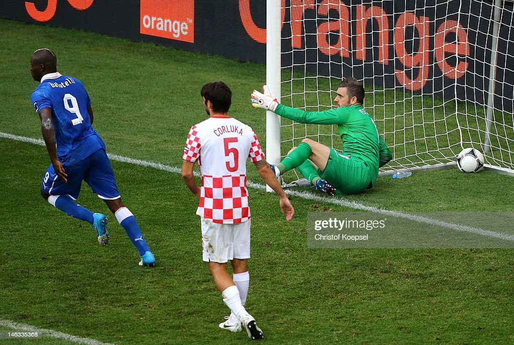 Stipe Pletikosa of Croatia fails to stop a goal from a Andrea Pirlo of Italy freekick during the UEFA EURO 2012 group C match between Italy and...