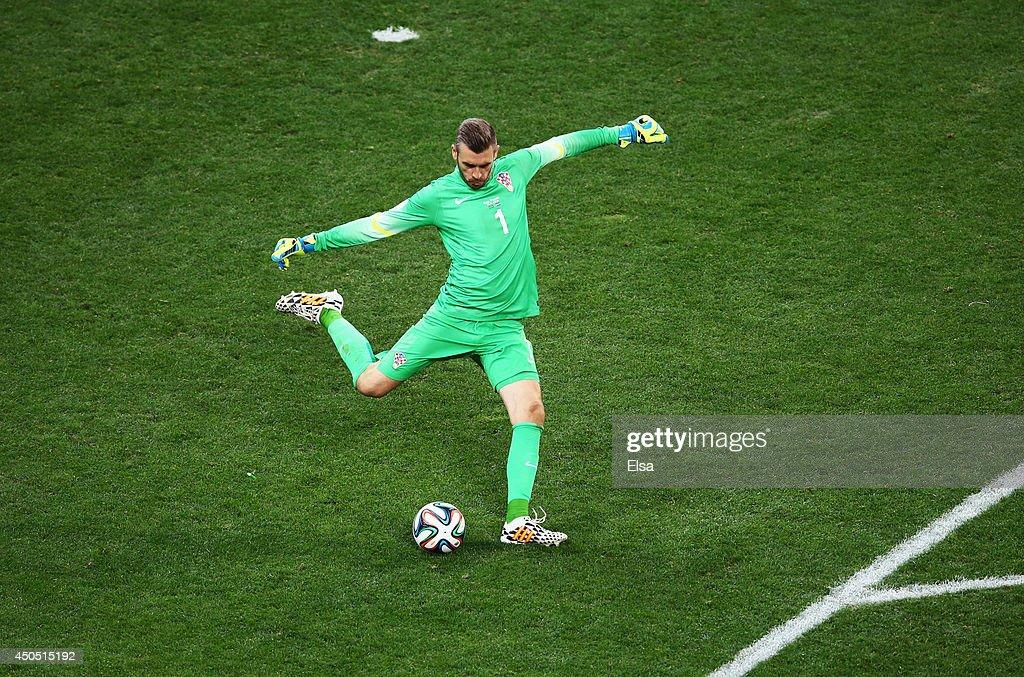 Stipe Pletikosa of Croatia kicks the ball during the 2014 FIFA World Cup Brazil Group A match between Brazil and Croatia at Arena de Sao Paulo on...