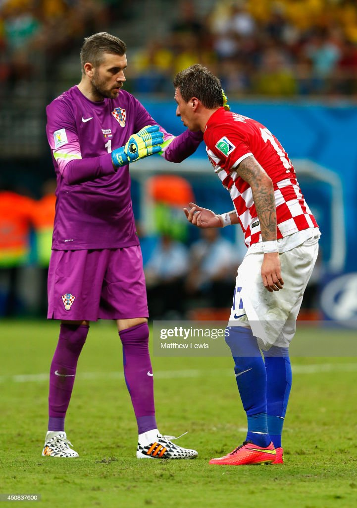 Stipe Pletikosa of Croatia speaks to a teammate during the 2014 FIFA World Cup Brazil Group A match between Cameroon and Croatia at Arena Amazonia on...