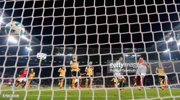 Stipe Vucur of Kaiserslautern scores the equalizer against goalie Marvin Schwaebe of Dresden during the Second Bundesliga match between SG Dynamo...