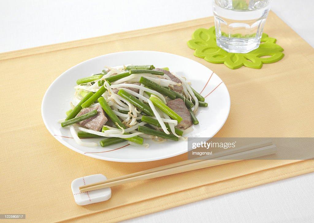 Stir fried pork and garlic stems : Stock Photo