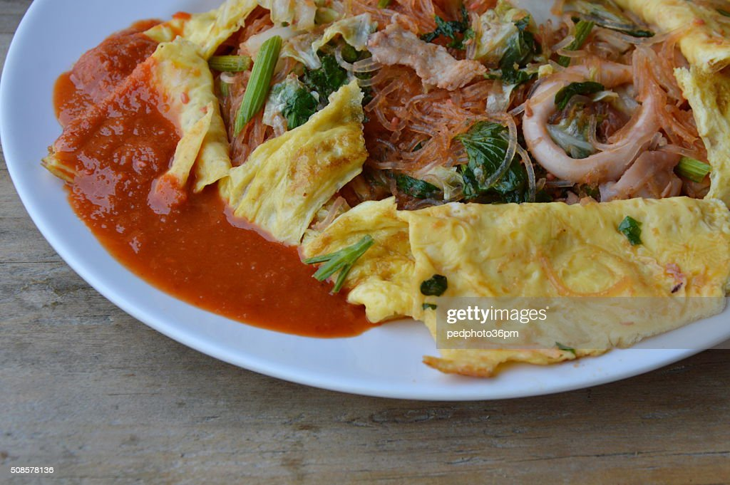 stir fried sukiyaki with seafood wrapped in egg and sauce : Stock Photo