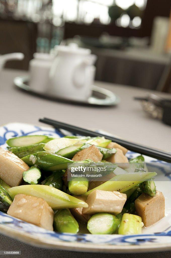 Stir-fried asparagus with pork cubes : Stock Photo