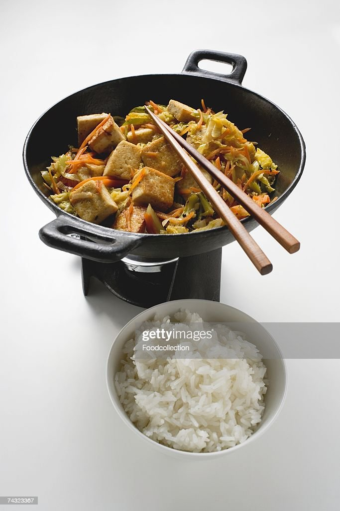 Stir-fried vegetables with fried tofu and rice : Stock Photo