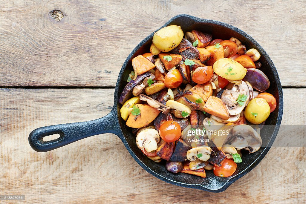 Stir-fried winter vegetables in a cast iron pan
