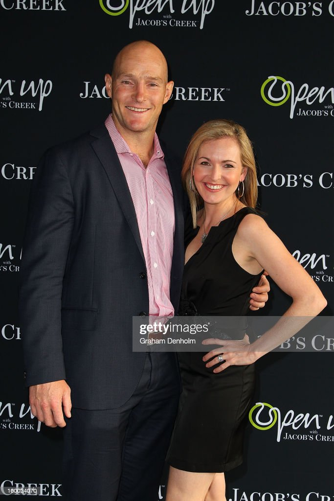 Stirling Mortlock (L) and wife Caroline Mortlock arrive at the screening of the Jacob's Creek Open Film Series 2 at Maia Docklands on January 25, 2013 in Melbourne, Australia.
