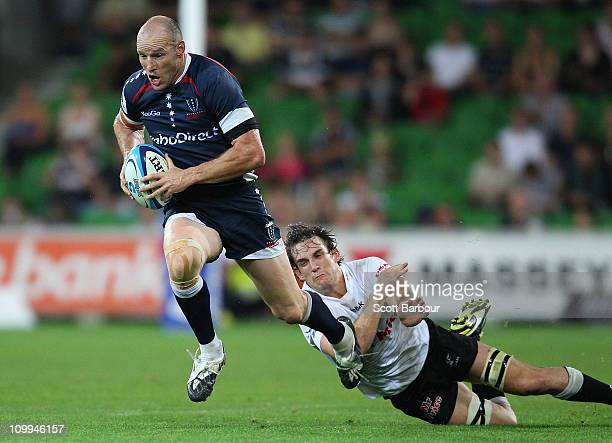 Stirling Mortlock of the Rebels makes a break during the round four Super Rugby match between the Melbourne Rebels and the Sharks at AAMI Park on...