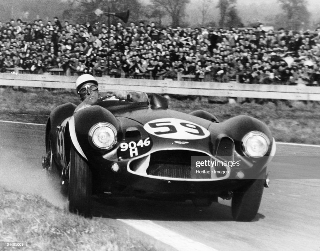 Stirling Moss diving an Aston Martin DB3S, Goodwood, West Sussex, 1956.