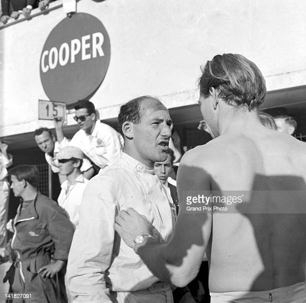 Stirling Moss driver of the Rob Walker Racing Team Lotus 21 Climax Straight4 talking with Innes Ireland driver of the Team Lotus Lotus 18/21 Climax...